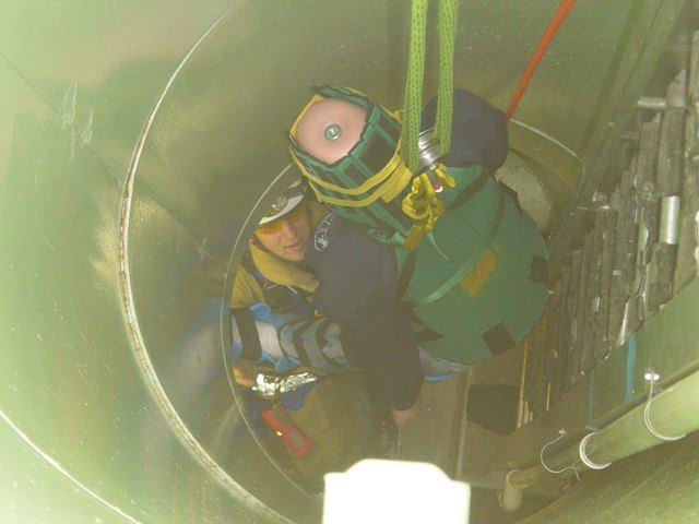 Mannequin, simulating a victim, is removed from a below-ground space at a confined space training.