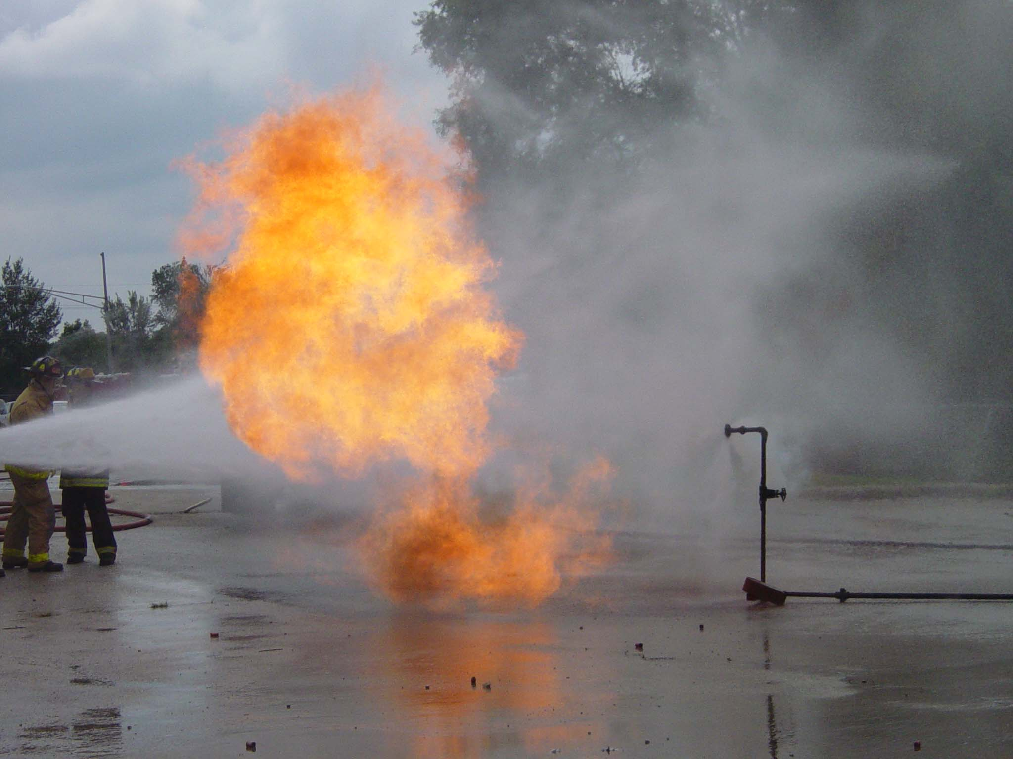 Fire crews attack a propane fire at a practical training drill taught by the Illinois Fire Service I